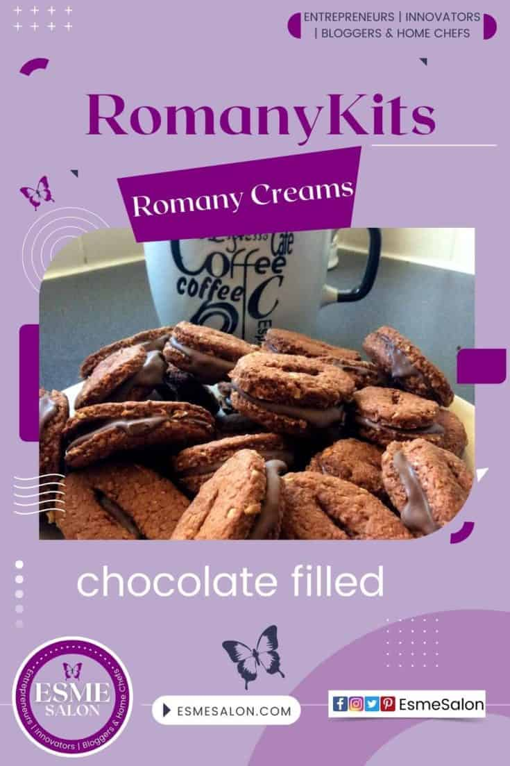 Romany cream cookies filled with chocolate sitting on a plate next to a white coffee mug