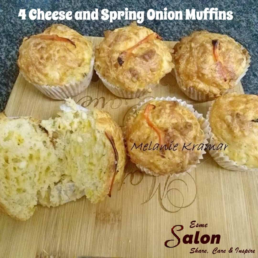 6 Muffins on a wood board, made with 4 different types of cheese