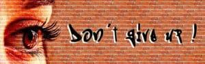 Woman's eye words on brick wall