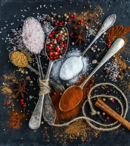 Spoons full of pepper, curry, rock salt