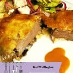 Beef Wellington with salad and gracy
