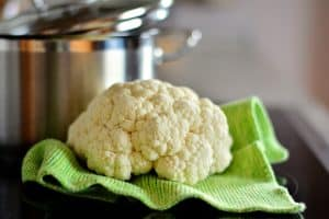 Cauliflower next to a cooking pot delicious