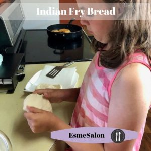 Stretching dough to prepare Indian Fry Bread