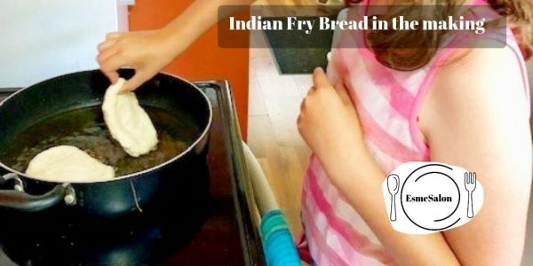 Placing dough in pan to bake Indian Fry Bread