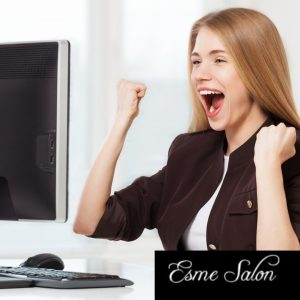 Excited lady behind computer screen