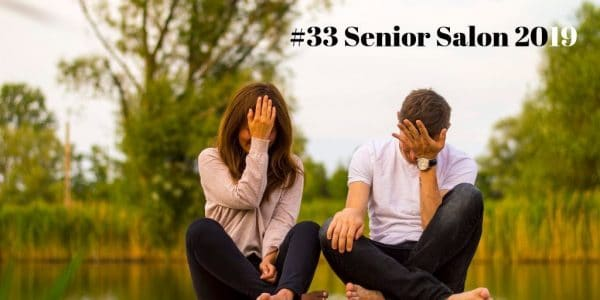 #33 Senior Salon 2019 Man and Woman Holding Forehead Sitting on Bridge