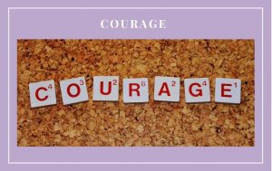 Courage spelled out on a cork board