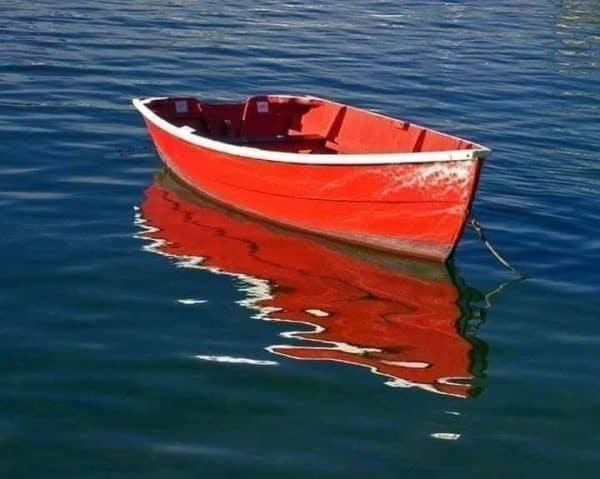 Read boat in the sea