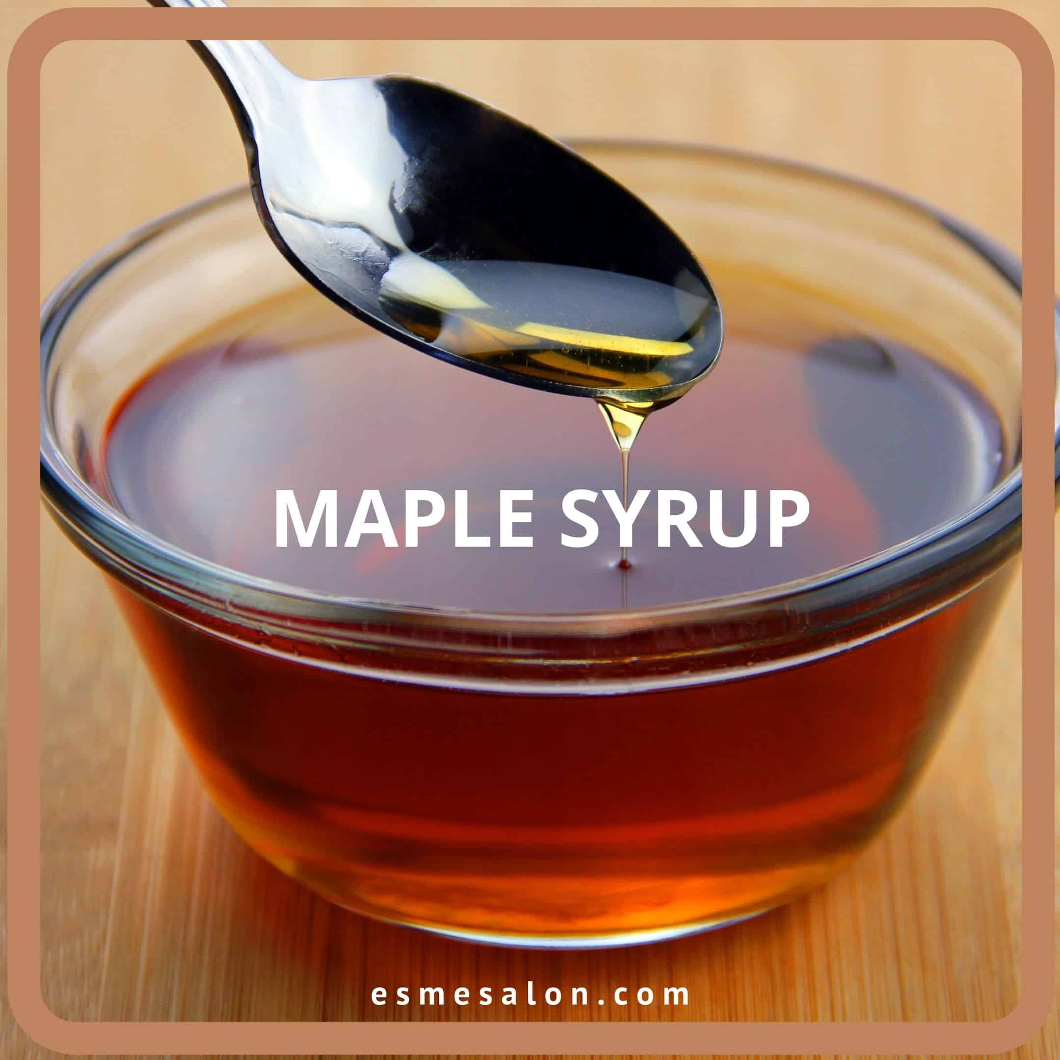 Spoon full of maple syrup poured into a bowl