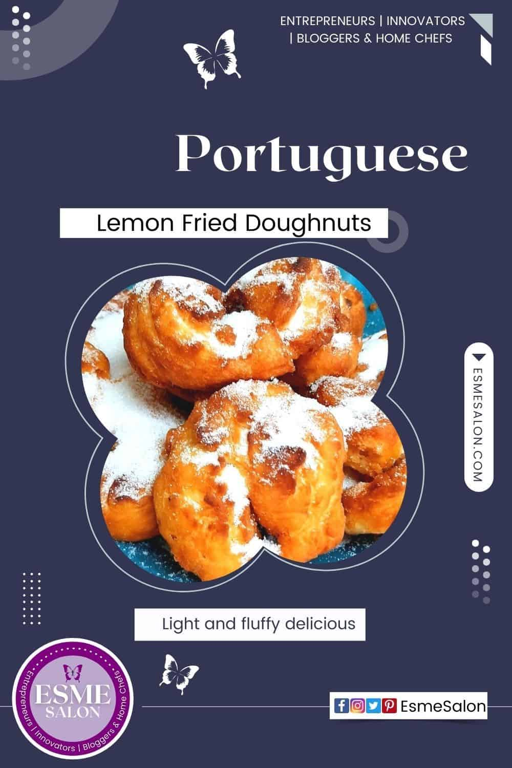 Lemon Fried Doughnuts with lots of sugar added to the top on a blue serving platter
